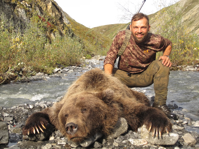Chris Haley with Trpohy Artic Grizzly Bear