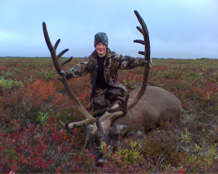 Jason Mc Kee with a great caribou taken with his father in the brooks  range 2008