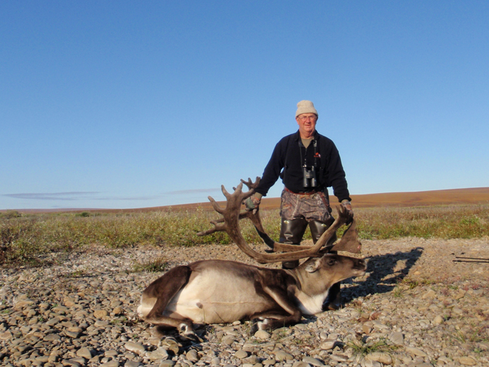 Thomas Albrecht with his trophy brooks rang caribou